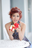 Beautiful young woman opening gift box Stock Images