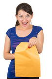 Beautiful young woman opening yellow envelope Stock Images
