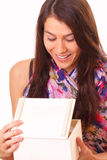 Beautiful young woman opens a holiday gift Royalty Free Stock Photography