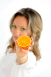 Beautiful young woman with orange Royalty Free Stock Photography
