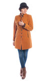 Beautiful young woman in orange coat Stock Images