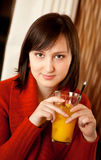 Beautiful young woman with orange juice Royalty Free Stock Images