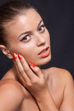 Beautiful young woman with orange lipstick and brown eyes Royalty Free Stock Image