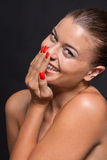 Beautiful young woman with orange lipstick and brown eyes Stock Images