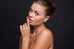 Beautiful young woman with orange lipstick and brown eyes Stock Image