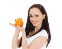 Beautiful young woman with an orange. Stock Images