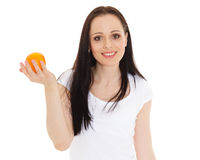 Beautiful young woman with an orange. Royalty Free Stock Photo