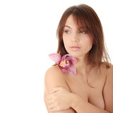 Beautiful young woman with orchid Royalty Free Stock Photos