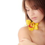 Beautiful young woman with orchid Stock Photography