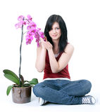 Beautiful young woman with orchid Royalty Free Stock Images