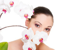 Beautiful young woman with orchid Royalty Free Stock Photo