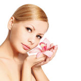 Beautiful young woman with orchid flower, isolated Stock Photo