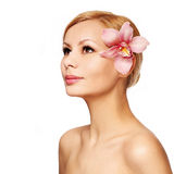 Beautiful young woman with orchid flower, isolated Royalty Free Stock Photos