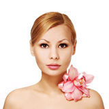 Beautiful young woman with orchid flower, isolated on white. Beautiful young woman with orchid flower, isolated. Face Care. Beauty Blonde Royalty Free Stock Photography