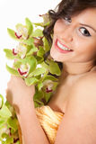 Beautiful young woman with orchid flowers Stock Image