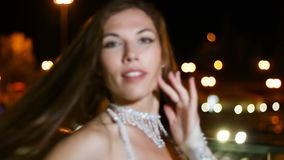 Beautiful young woman in oriental ethnic costume dances at night outdoor.  stock footage