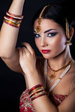 Beautiful young woman with oriental makeup and Indian Jewelry Royalty Free Stock Images