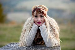 Beautiful young woman outdoor in autumn Stock Photos