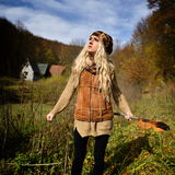 Beautiful young woman outdoor on autumn day Stock Photography