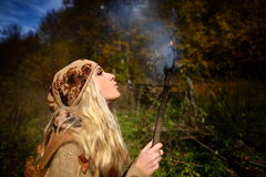 Beautiful young woman outdoor holding burning torc Royalty Free Stock Image