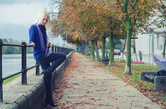 Beautiful young woman outdoor on rainy autumn day Stock Photography