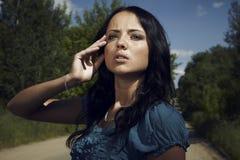 Beautiful young woman outdoors. Photo Stock Image
