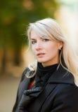 Beautiful young woman outdoors Stock Photos