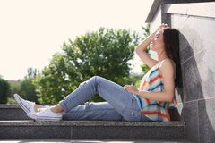 Beautiful young woman outdoors. On sunny day Royalty Free Stock Photo