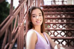 Beautiful young woman outdoors. On sunny day Stock Image