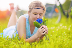 Beautiful Young Woman Outdoors. Calm Relaxing Girl on Green Gras Stock Photo
