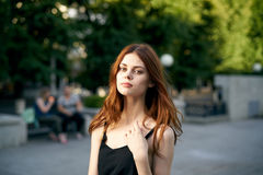 Beautiful young woman outdoors in the city, fashion, beauty.  Stock Photos