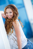 Beautiful young woman outdoors in the city Stock Images