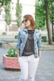 Beautiful young woman outdoors. Cute girl in summer Stock Photo