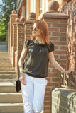 Beautiful young woman outdoors. Cute Red-haired girl in summer Royalty Free Stock Images