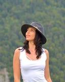 Beautiful young woman outdoors. Enjoying nature Stock Photography