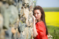 Beautiful young woman outdoors enjoying nature Stock Image