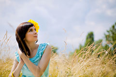 Beautiful young woman outdoors on the meadow Royalty Free Stock Photography