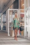 Portrait of young shopaholic woman royalty free stock photos