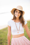 Beautiful young woman outdoors in sun hat. Royalty Free Stock Image