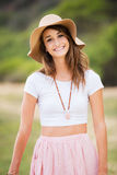 Beautiful young woman outdoors in sun hat. Stock Image