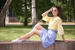 Beautiful young woman outdoors. On sunny day Royalty Free Stock Images