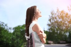 Beautiful young woman outdoors. On sunny day Stock Photos