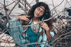Beautiful young woman outdoors. witch craft concept royalty free stock image
