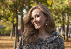 Beautiful young woman outside in autumn city park Royalty Free Stock Images