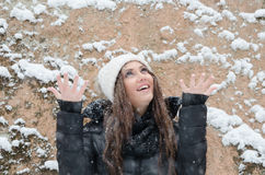 Beautiful young woman outside while its snowing Stock Photo