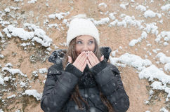 Beautiful young woman outside while its snowing Royalty Free Stock Image