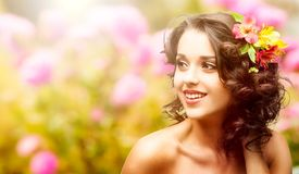 Beautiful young woman over autumn background. Beautiful young woman with flowers in hair over autumn background Royalty Free Stock Image
