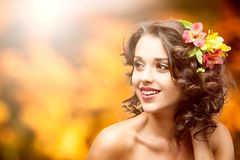 Beautiful young woman over autumn background Royalty Free Stock Images