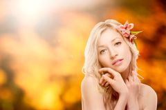 Beautiful young woman over autumn background Royalty Free Stock Photography