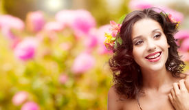 Beautiful young woman over autumn background. Beautiful young woman with flowers in hair over autumn background Royalty Free Stock Photo